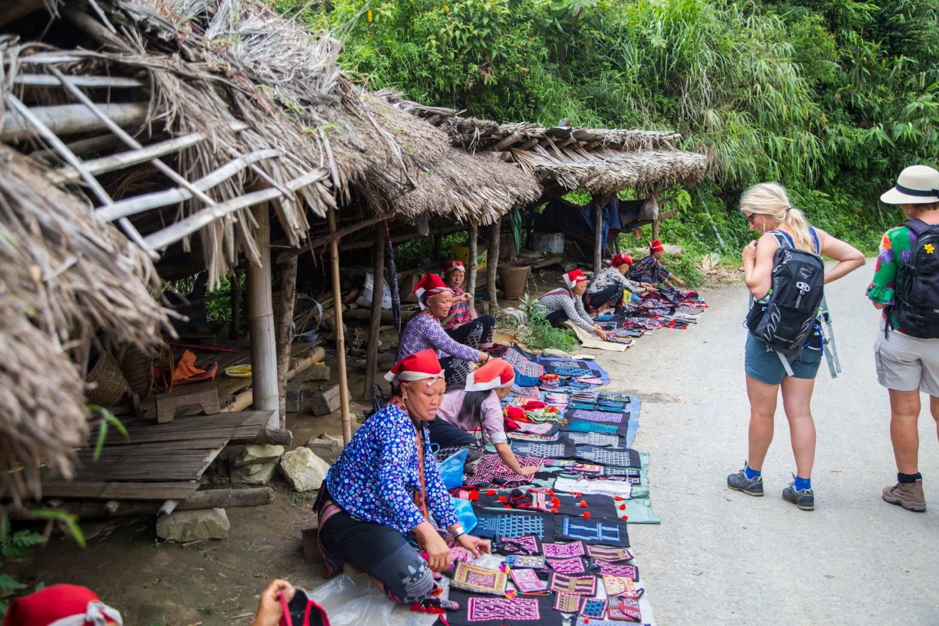 Local minority market where Red Dao tribe women sell their handicraft