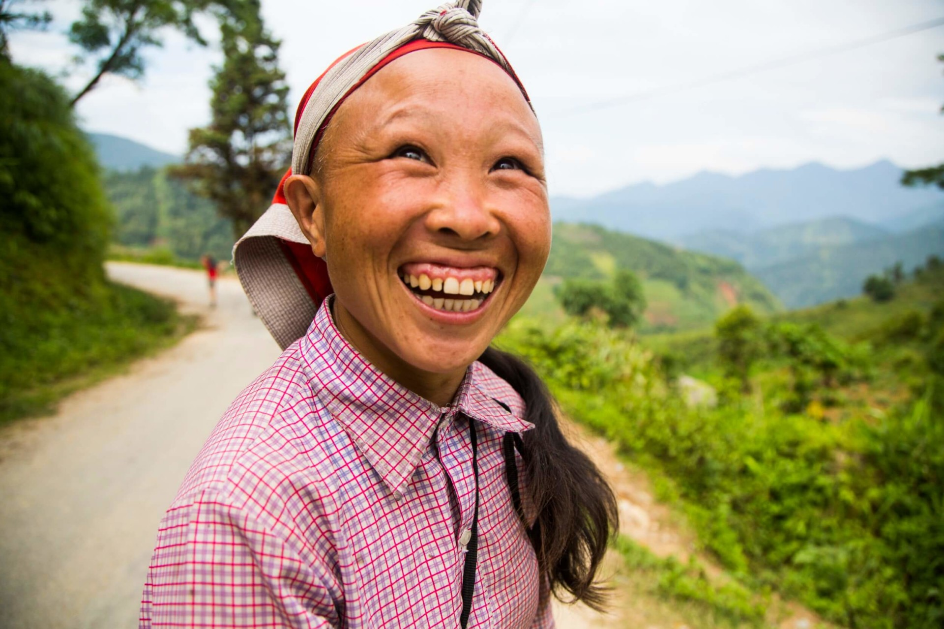 Happy Red Zao woman smiling to the camera