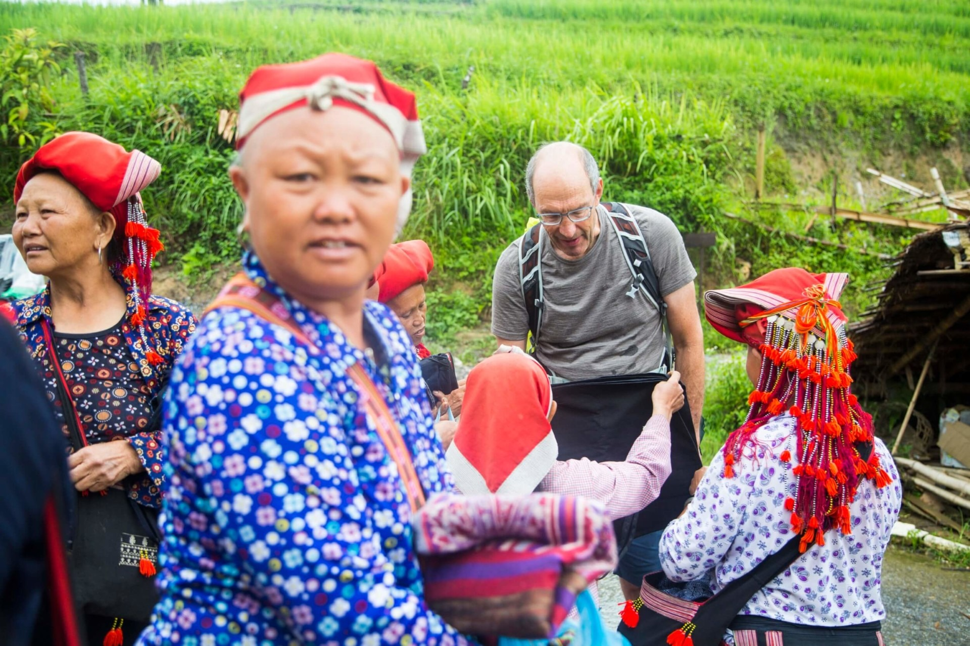 Tourist buying local handcraft from Red Zao minority women