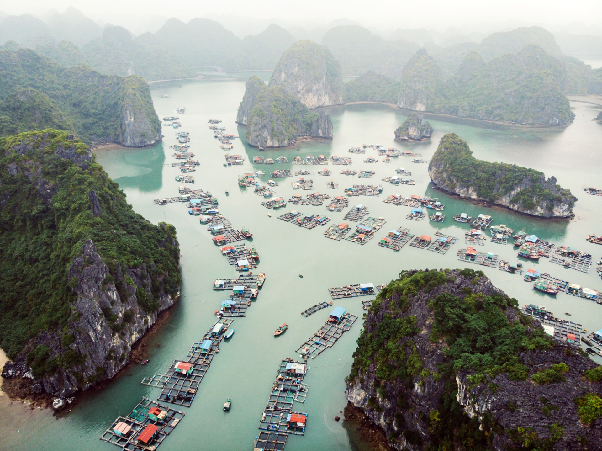 Aerial view of floating villages around Cat Ba islands. Cat Ba is the largest of the 366 islands, which make up the southeastern edge of Ha Long Bay in Vietnam